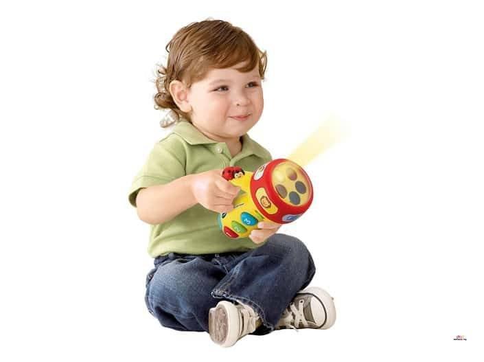Image of cute boy with VTech Flashlight