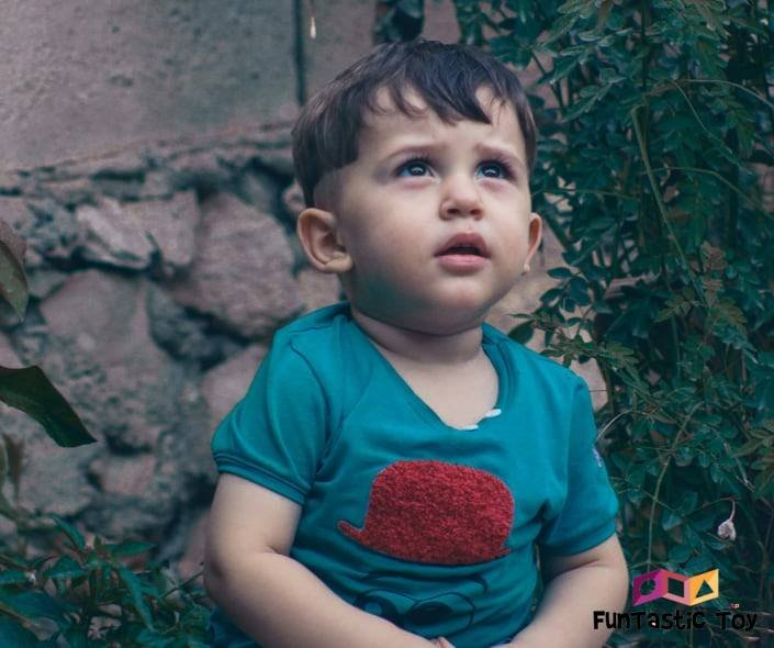 Image of cute toddler boy in the yard