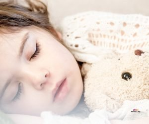 Image of cute toddler girl napping