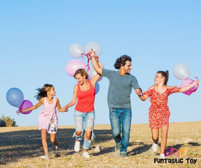 Image of happy family with balloons
