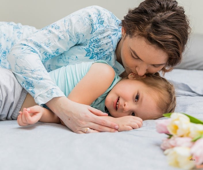 Image of mother waking her daughter up