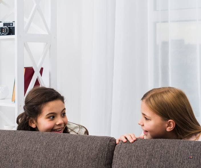 Image of two girls hiding