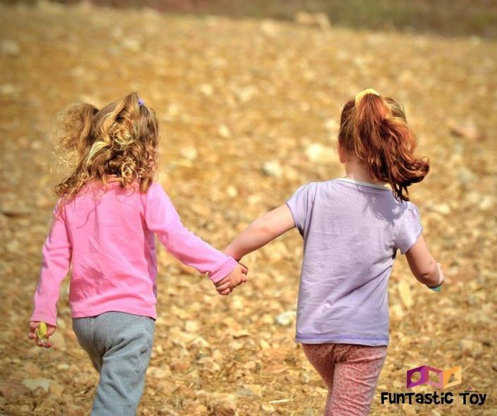 Image of two girls holding hands