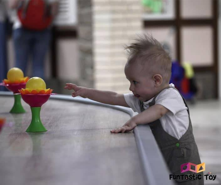 Featured image of baby reaching at yellow toy