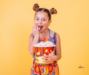 Featured image of cute girl eating popcorn