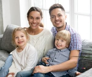 Featured image of family on sofa smiling