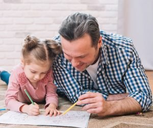 Featured image of father and daughter drawing on floor
