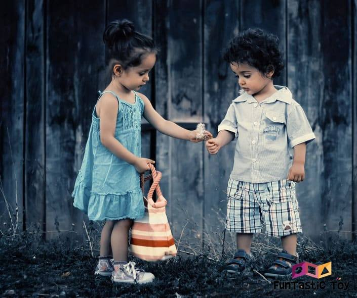 Featured image of little boy and girl holding dandelion