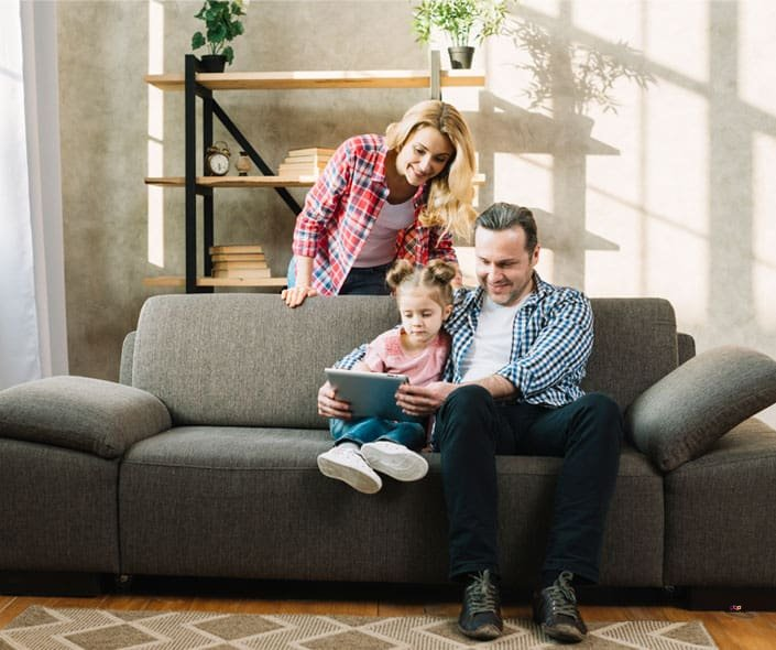 Featured image of Family on sofa with tablet