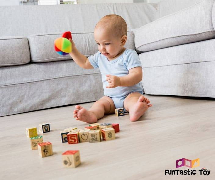 Image of baby playing with blocks on floor
