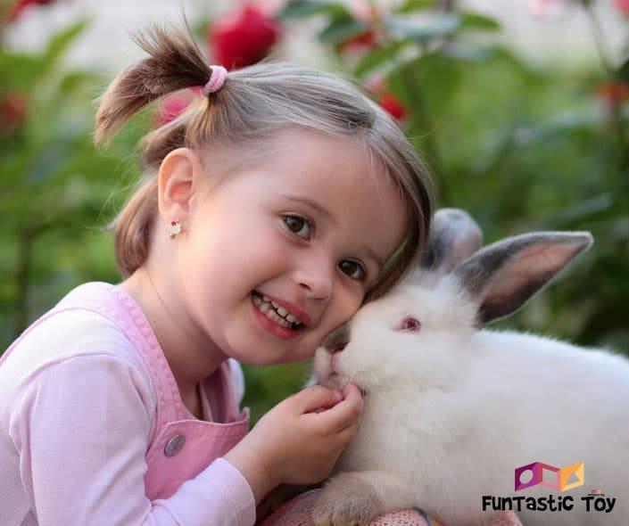 Image of cute girl petting white rabbit