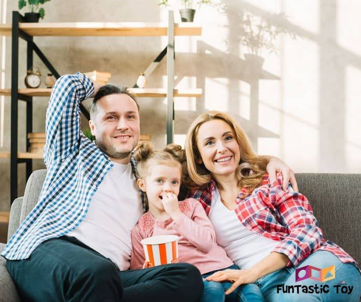 Image of family on sofa watching TV