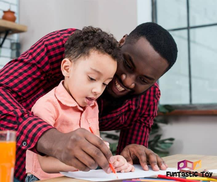 Image of father and son drawing