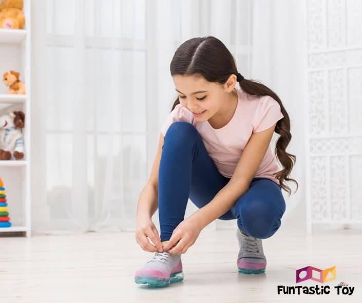 Image of girl tying shoelaces