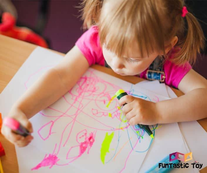 Image of little girl drawing with markers