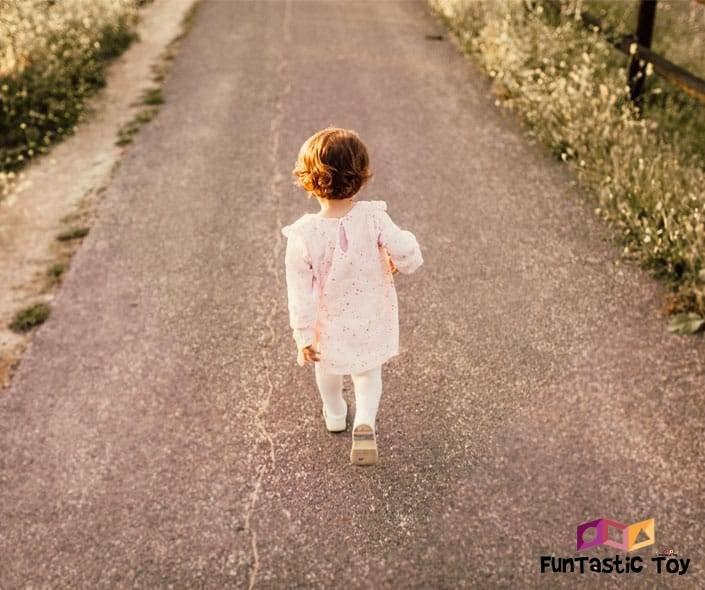 Image of little girl walking on road