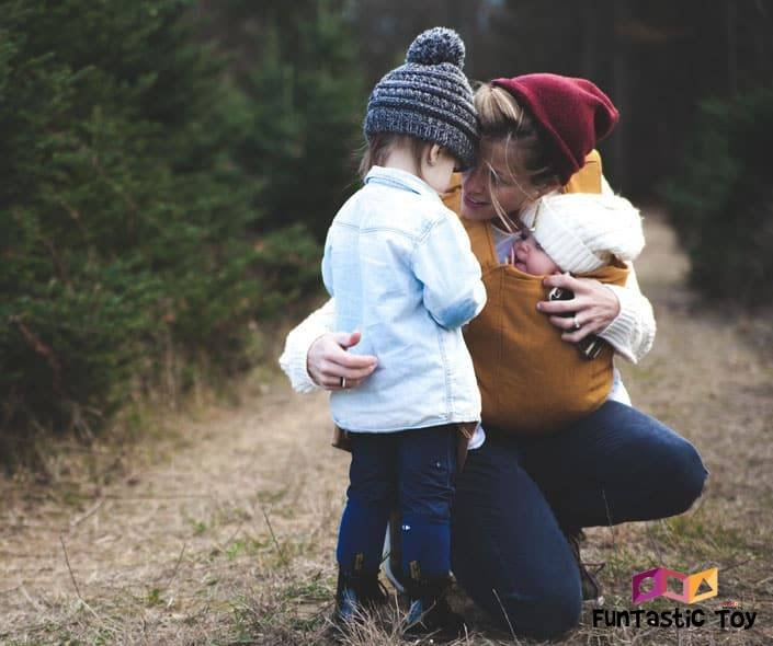 Image of mother with daughter and baby in nature