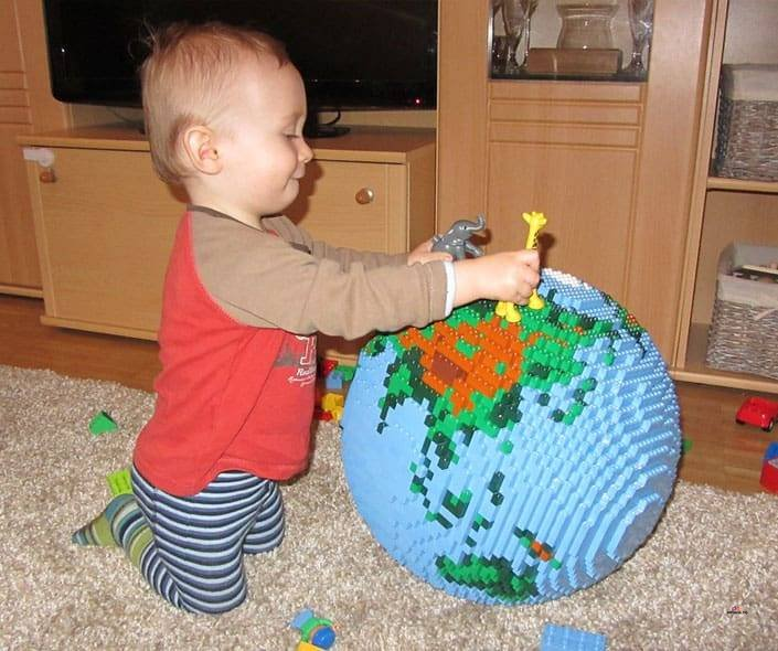 Image of toddler playing with lego globe