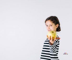 Featured image of girl in black and white offering apple
