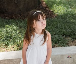 Featured image of sad little girl in white