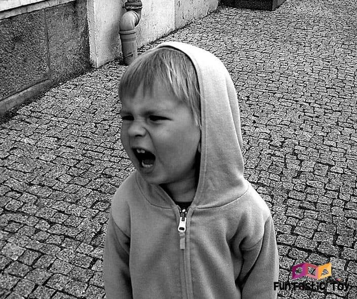 Image of angry boy in hoodie shouting