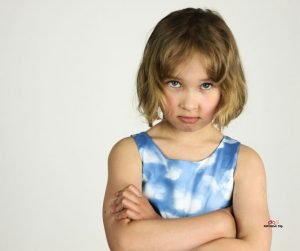 Featured image of angry girl in blue with crossed arms