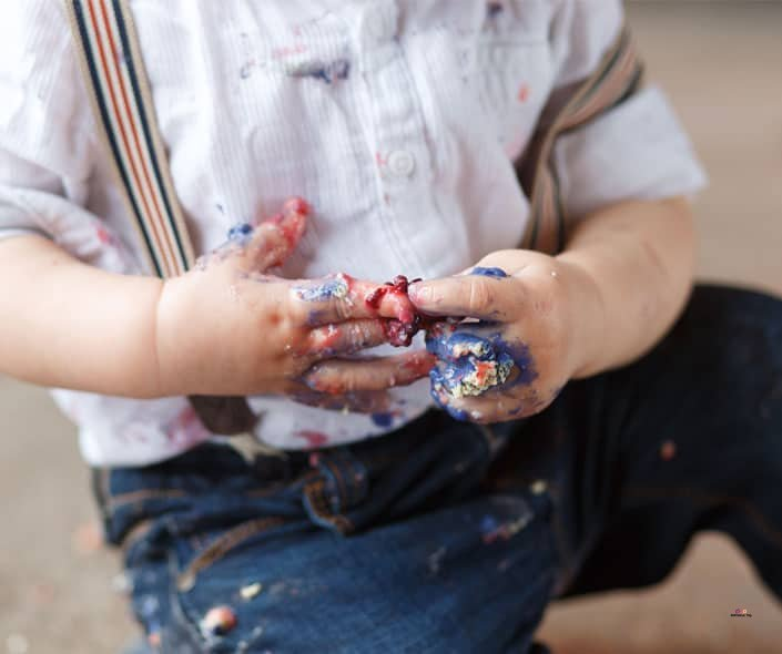 Featured image of dirty baby with cake on hands