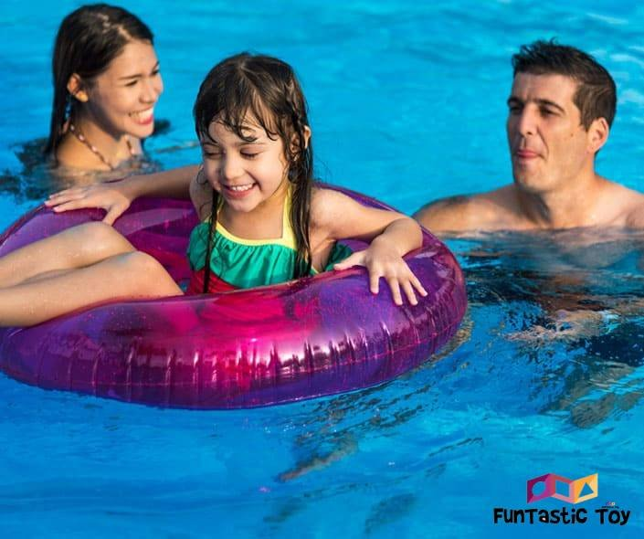 Featured image of smiling family in swimming pool