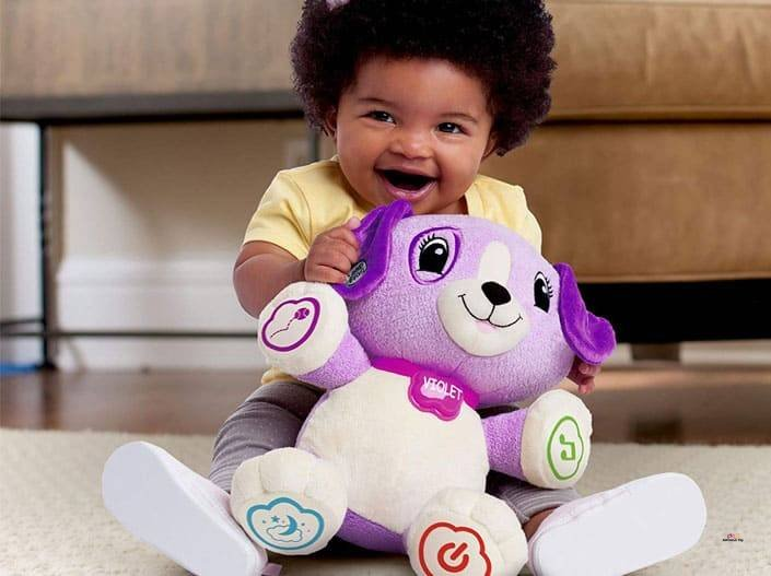 Image of happy little girl playing with Leapfrog My Pal Violet