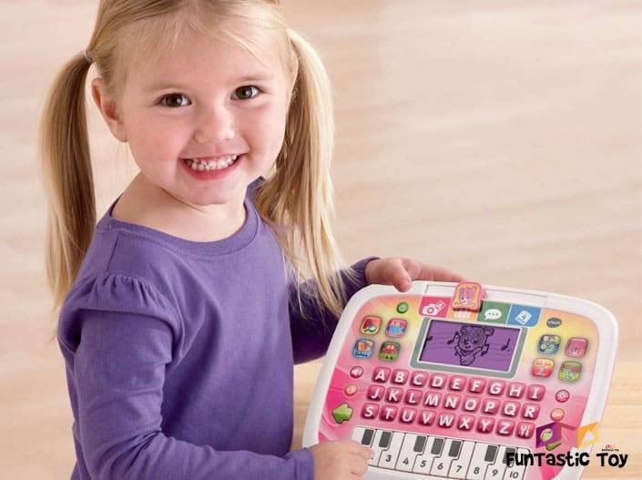 Image of smiling little girl with Little Apps Tablet