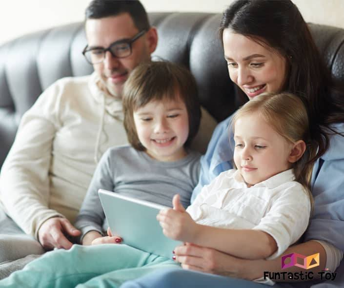 Featured image of family with two children watching movie on tablet