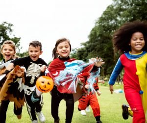 Featured image of happy children running in costumes