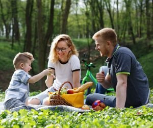 Featured image of happy parents and boy in park on picnic
