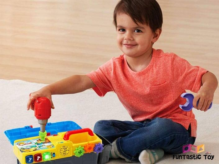Image of boy playing with VTech Drill & Learn Toolbox