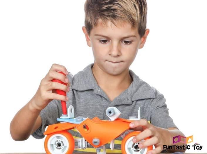 Image of boy using Engineering Building Toys set