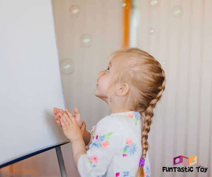 Image of girl with braided ponytail next to whiteboard