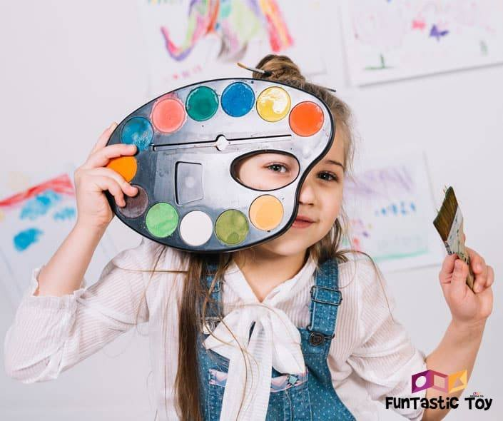 Image of girl with painting palette and paint brush