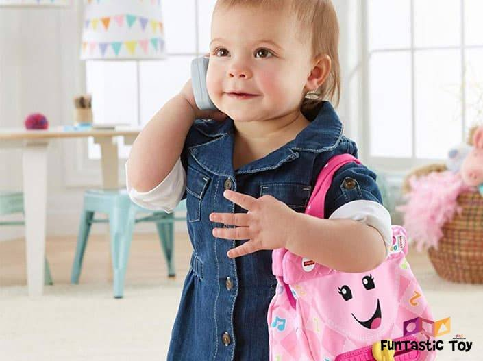 Image of toddler girl playing with Fisher-Price Laugh & Learn My Smart Purse