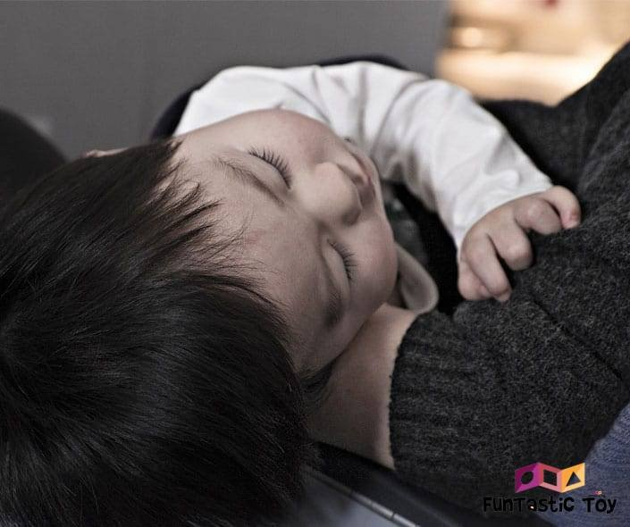 Featured image of baby boy sleeping in parents arms