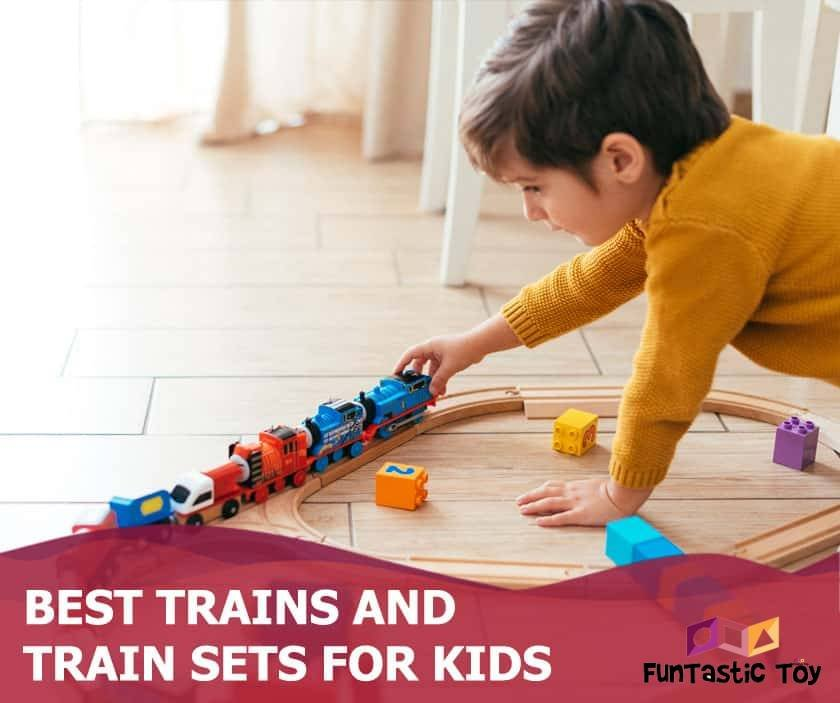 Featured image of boy playing with train set on floor