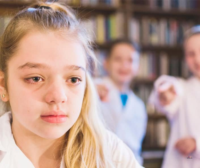 Featured image of crying girl in white being bullied