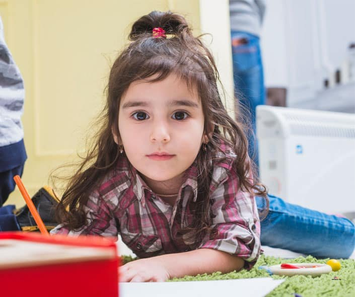 Featured image of cute little girl drawing on floor