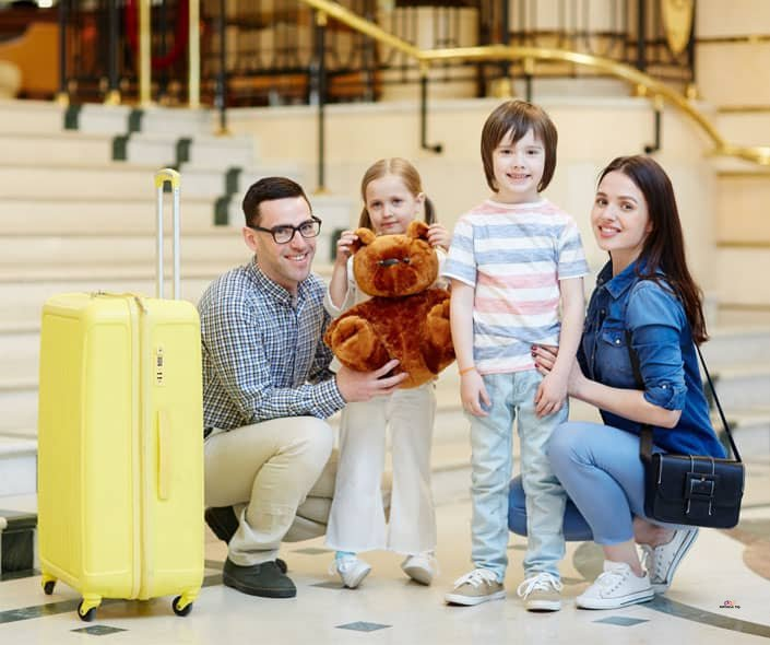 Featured image of family traveling with two children