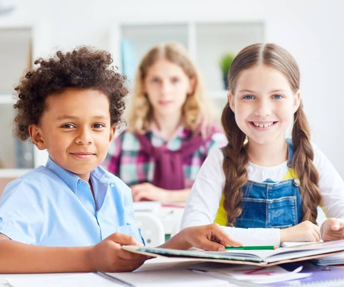 Featured image of girl and boy with notebooks sitting in class
