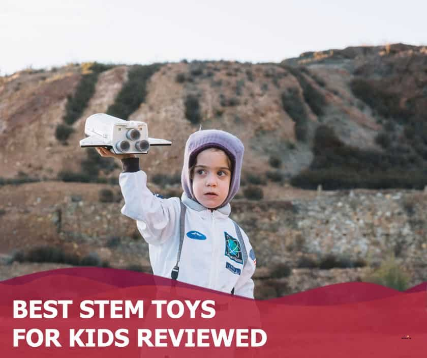 Featured image of little girl in astronaut suit holding space shuttle toy