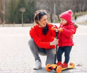 Featured image of mother and little girl in red on scooter