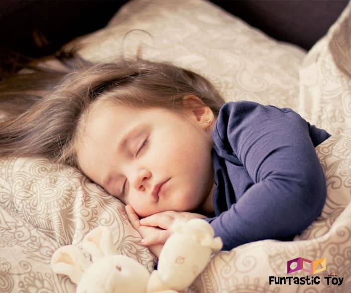 Image of adorable baby girl sleeping in bed