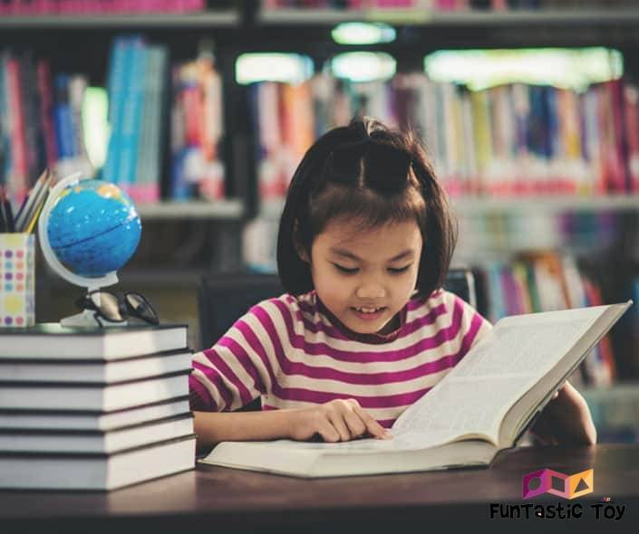 Image of asian girl studying in library