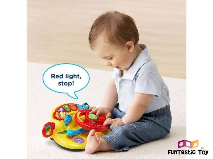 Image of boy playing with VTech Turn and Learn Driver Toy