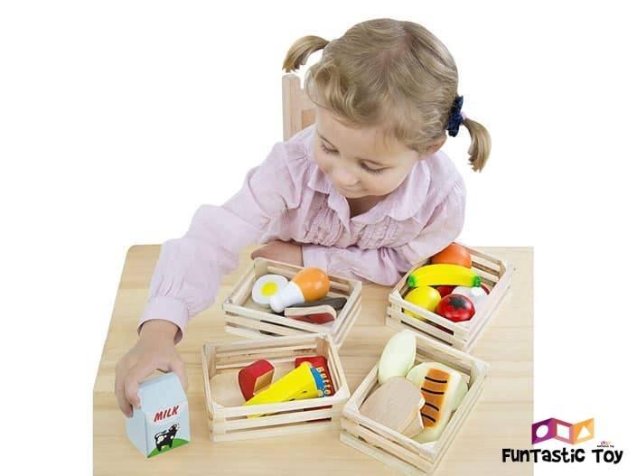 Image of girl playing with Melissa and Doug Food Groups Set